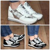 белие и черные кроссовки с принтом под кожу питона