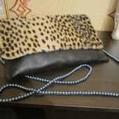 Стильный клатч с леопардовым принтом
