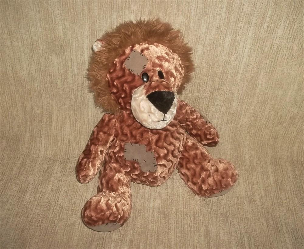 Мягкая игрушка лев фото №1