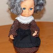 Самозаводящаяся коллекционная кукла с мелодией