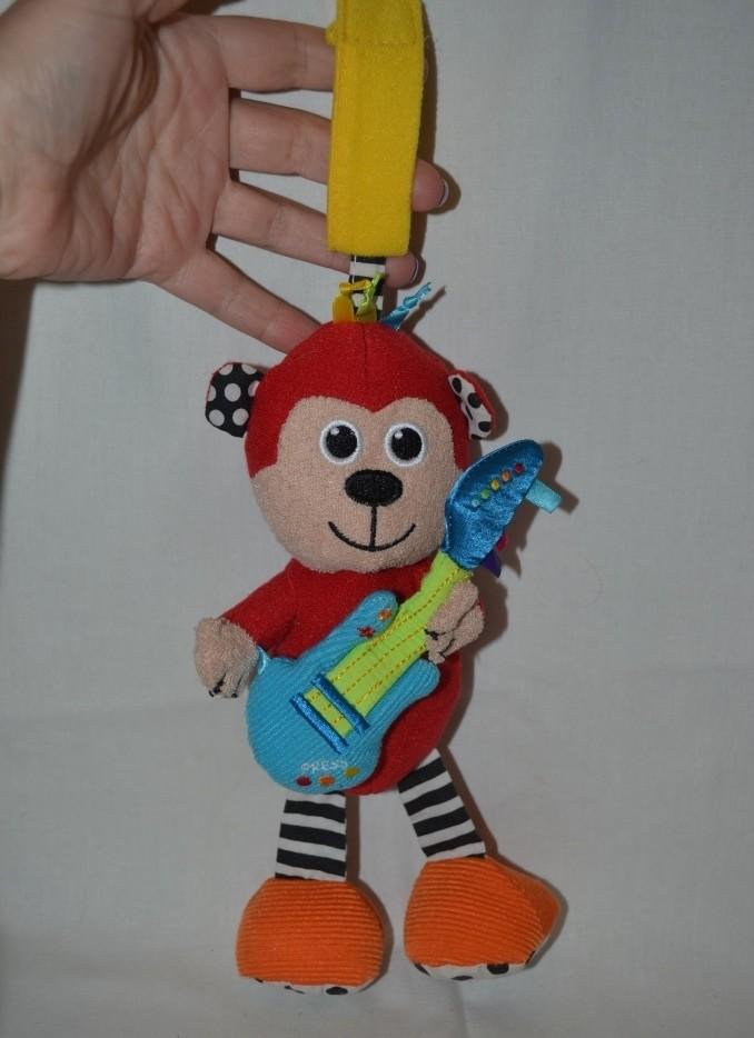 Прикольная фирменная подвеска погремушка обезьянка мартышка музыкальная рокер фото №1
