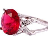 Кольцо,покрытое белым золотом с красным цирконом