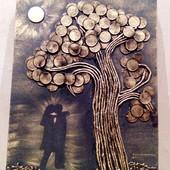 Картина из монет двое влюбленных