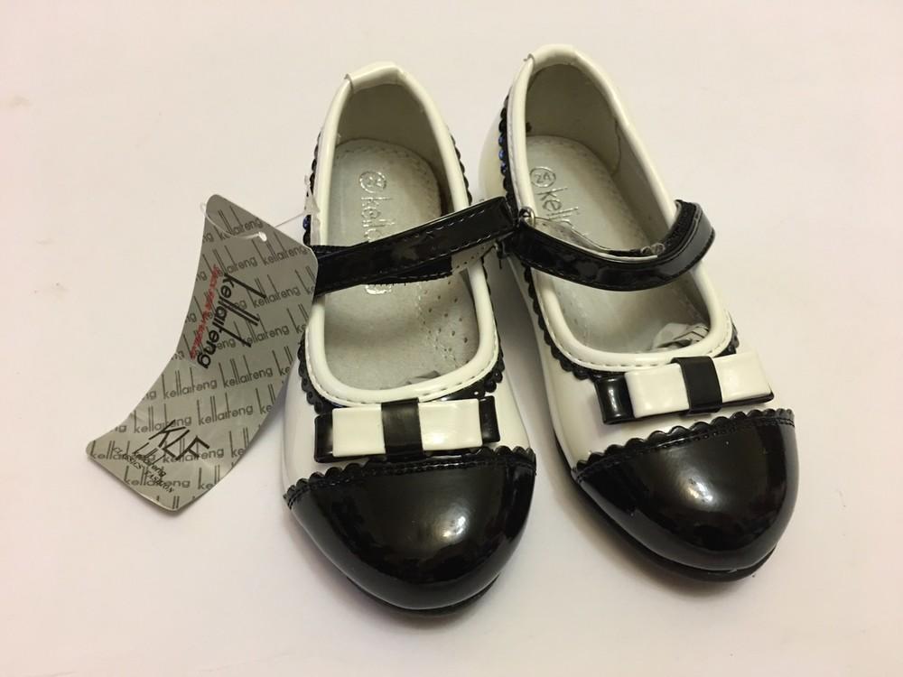 Туфли для девочки белые с черной вставкой фото №9