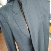 Новий костюм чорний у полоску