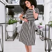 Элегантное женское платье в полоску