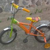 Детский велосипед Мадагаскар с боковыми колесиками
