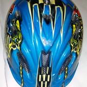 Фирменный шлем с регулировкой на ог 52-55 см