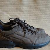 Основательные серо-коричневые кожаные фирменные кроссовки Reebok DMX 47 р.