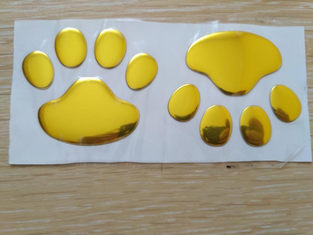 Выпуклая наклейка на авто следы золото фото №1