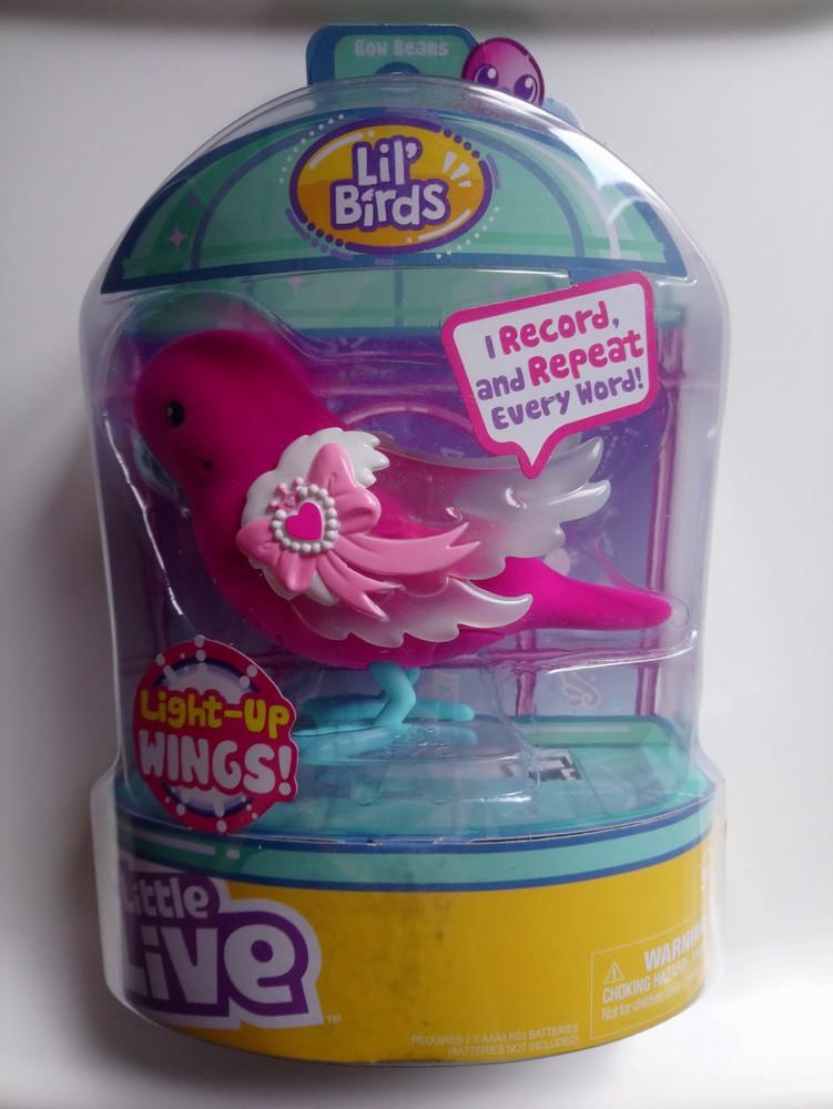 Інтерактивна іграшка. пташка, що співає і розмовляє фото №1